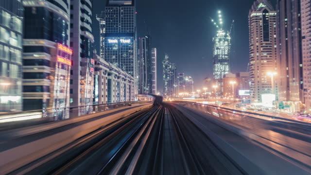 t / l pov metro kör genom downtown dubai på natten / dubai, uae - fönsterrad bildbanksvideor och videomaterial från bakom kulisserna