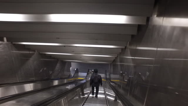 metro escalator and rer with a few people, les halles metro station during a national strike in paris, france, on thursday, dec. 5, 2019. in what has... - struttura cellulare video stock e b–roll
