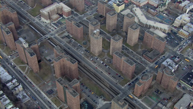 A Metro North train passes through housing projects in the Bronx.