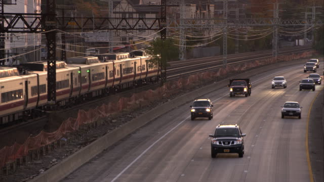 Metro North Train travels the opposite direction of interstate 95 by Larchmont New York