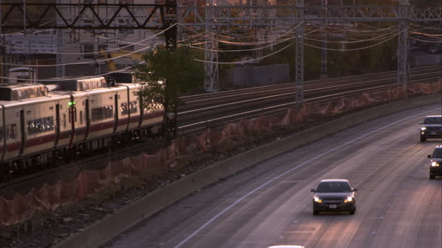 metro north train travels the opposite direction of interstate 95 by larchmont new york - north york stock videos & royalty-free footage