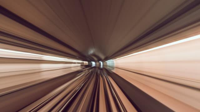 t/l pov metro rail riding through tunnel / dubai, vae - train vehicle stock-videos und b-roll-filmmaterial