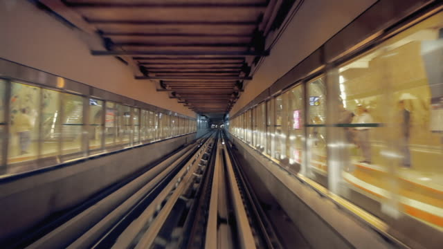 ws pov metro rail riding underground station / dubai, united arab emirates - underground rail stock videos & royalty-free footage