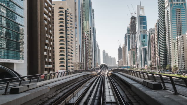 t/l pov metro riding through downtown dubai / dubai, uae - vanishing point stock videos & royalty-free footage