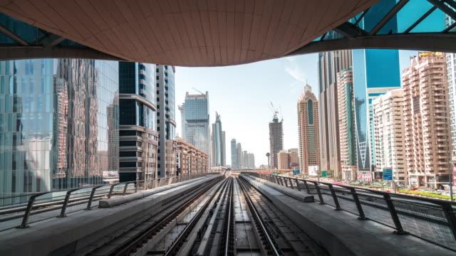 t/l pov metro riding through downtown dubai / dubai, uae - train point of view stock videos & royalty-free footage