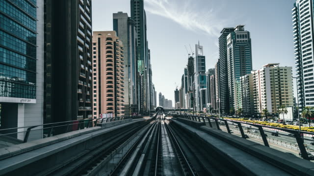 t/l metro riding through downtown / dubai, uae - driverless transport stock videos & royalty-free footage