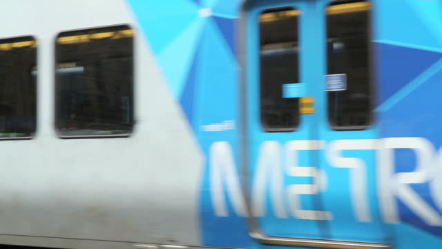 MS Metro train arriving and commuters at Flinders Street Station / Melbourne, Victoria, Australia