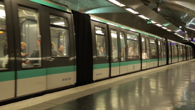 metro train at saint-germain-des-pres, paris, france, europe - underground rail stock videos & royalty-free footage