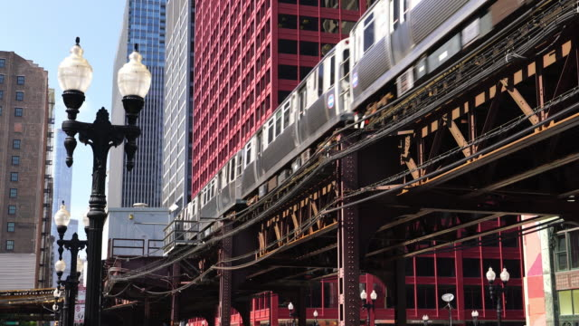 metro train in downtown chicago - chicago illinois stock videos & royalty-free footage