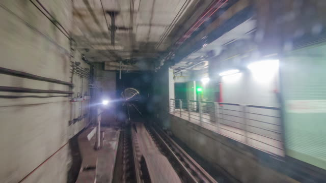 MRT Metro train moving through Underground tunnel at high speed, Singapore