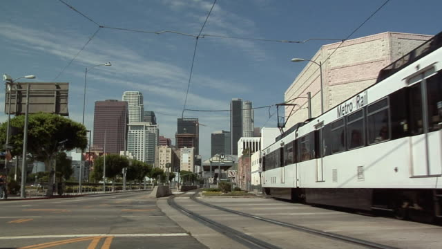 MS, Metro train station on Pico Boulevard, downtown skyline in background, Los Angeles, California, USA