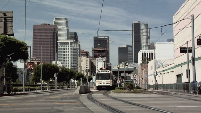 ms, metro train station on pico boulevard, downtown skyline in background, los angeles, california, usa - downtown stock videos & royalty-free footage