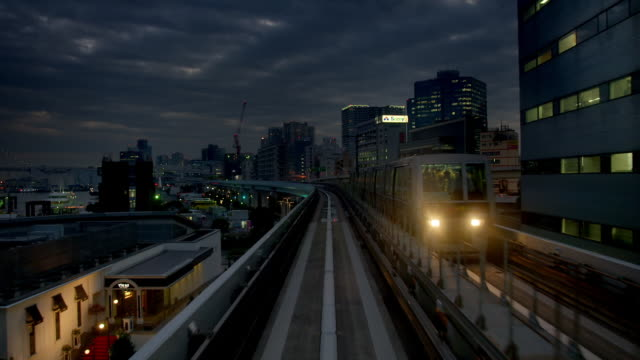 metro trains at night in tokyo, japan - railway track stock videos & royalty-free footage