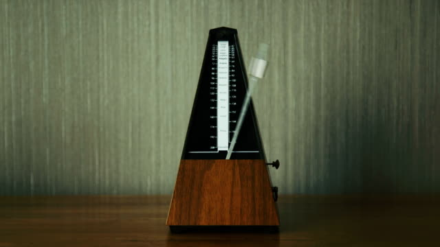 Metronome on Wooden Table