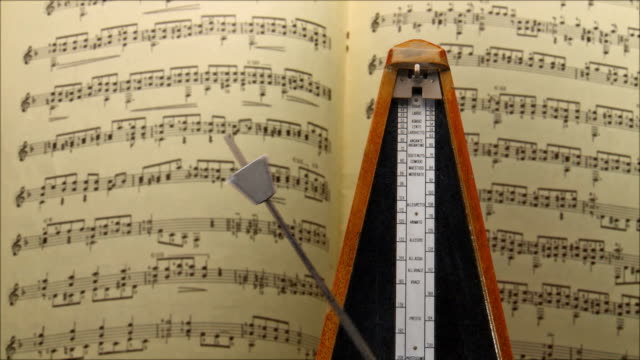 metronome with sheet music - musical note stock videos & royalty-free footage