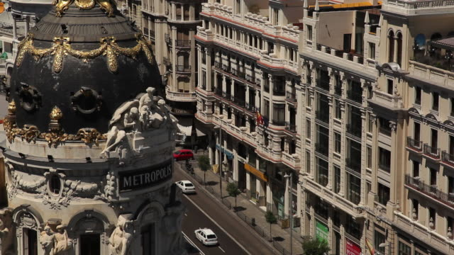 MS HA Metropolis Building and traffic on Gran Via / Madrid, Spain