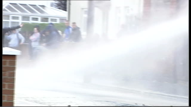 metropolitan police back call for water cannons lib belfast ext water cannon used to disperse rioters - water cannon stock videos and b-roll footage