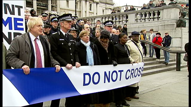 metropolitan police chief targets london gang members gvs launch of initiative johnson and hoganhowe posing behind police cordon banner / press at... - toughness stock videos and b-roll footage