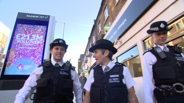 metropolitan police commissioner cressida dick walking along a street with two police officers - コミッショナー点の映像素材/bロール