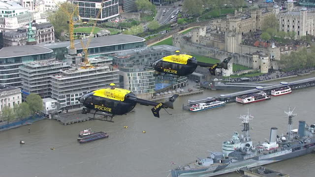 Metropolitan police helicopters and boats performing tributes to PC Keith Palmer on the day of his funeral
