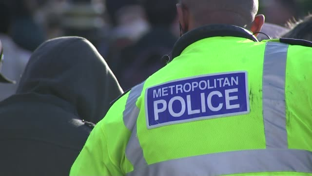 metropolitan police internal discrimination report t20111507 anonymous shot of man with hands handcuffed behind his back 'metropolitan police' name... - hands behind back stock videos and b-roll footage