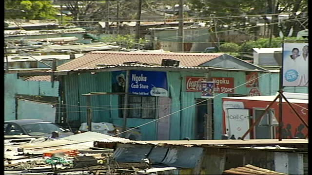 metropolitan police sharing knowledge with south african police general views of squatter camp child seen through broken window close up gun on... - gun belt stock videos and b-roll footage