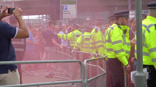 metropolitan police stretching resources to prevent violence at matches england london wembley stadium ext fight between football fans broken up by... - fan enthusiast stock videos & royalty-free footage