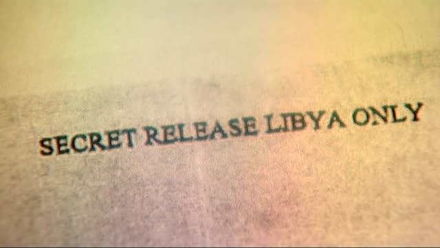Metropolitan Police to investigate MI6 over Libyan rendition allegations LOCATION Close shot of document reading 'Secret Release Libya Only' Close...