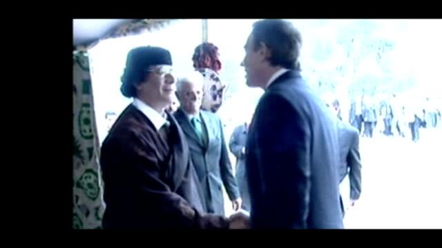 metropolitan police to investigate mi6 over libyan rendition allegations; lib libya: int tent ** beware flash photography ** slow motion seq tony... - mi6 stock-videos und b-roll-filmmaterial