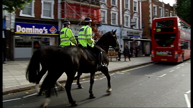 Metropolitan Police train dancing horse to fight crime ENGLAND London West Hampstead EXT Claire Twigg sitting on Lorcan Low angle view mounted police...