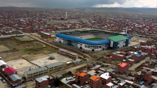 metros de altura el estadio del club boliviano always ready es uno de los mas altos del planeta y el unico techado y con cesped sintetico del pais - planeta stock videos & royalty-free footage