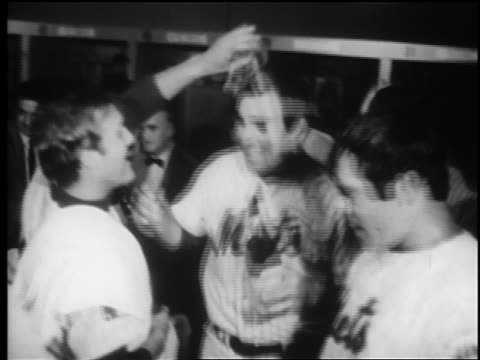 mets players celebrating in locker room with champagne after winning world series / newsreel - shea stadium stock videos and b-roll footage