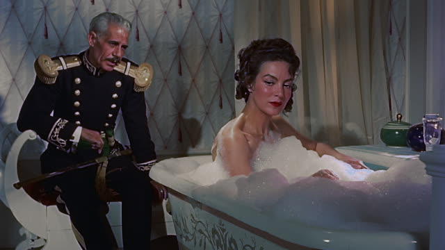 stockvideo's en b-roll-footage met mexican actress maria felix in the bathtub while talking to a general during mexican revolution. - bubbelbad