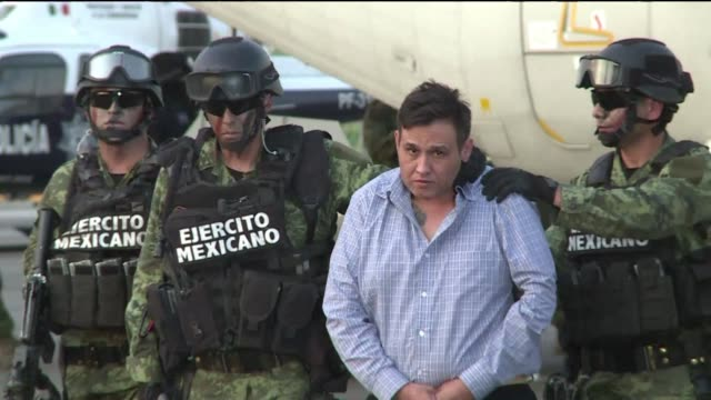 mexican authorities captured zetas drug cartel leader omar trevino wednesday dealing a blow to the feared gang and giving the embattled government a... - drug cartel stock videos and b-roll footage
