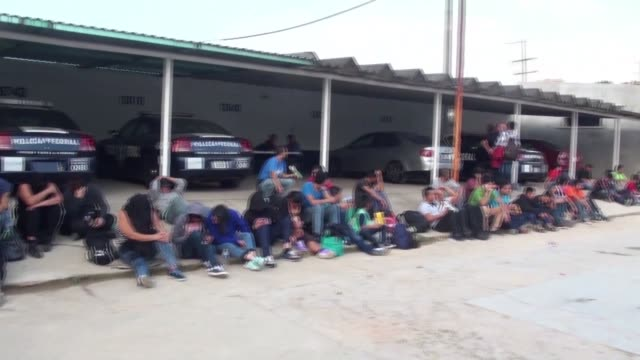 mexican authorities on thursday discover 111 undocumented central american migrants in the back of a tractor trailer that crashed and was abandoned... - trafficking stock videos & royalty-free footage