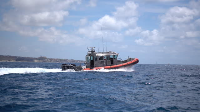 a mexican coast guard boat in cabo san lucas, mexico. - cabo san lucas stock videos & royalty-free footage