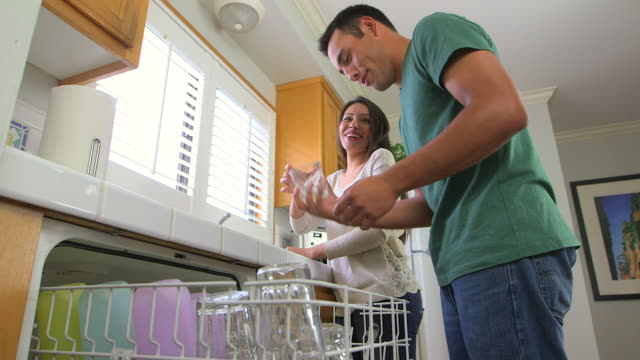 mexican couple doing chores - dreiviertelansicht stock-videos und b-roll-filmmaterial