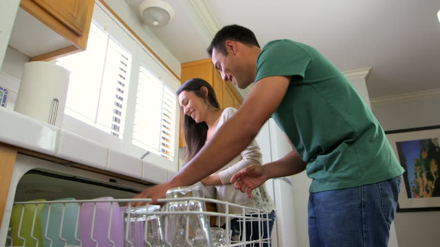 mexican couple doing dishes - dreiviertelansicht stock-videos und b-roll-filmmaterial