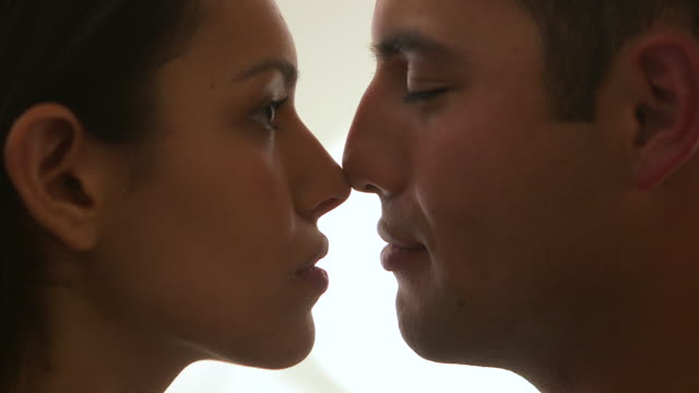 mexican couple looking into each other's eyes - bruciare video stock e b–roll