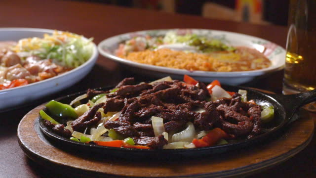 mexican cuisine sizzling beef steak fajitas in a fancy mexican restaurant - mexican food stock videos & royalty-free footage