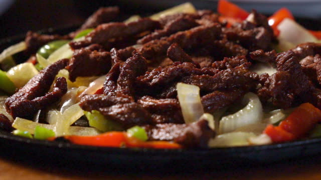 mexican cuisine sizzling beef steak fajitas in a fancy mexican restaurant - pepper seasoning stock videos and b-roll footage