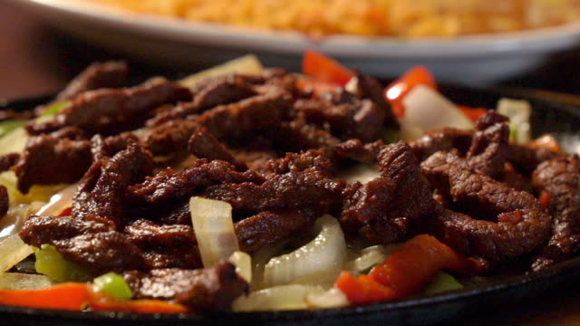 mexican cuisine sizzling beef steak fajitas in a fancy mexican restaurant - salsa stock videos & royalty-free footage