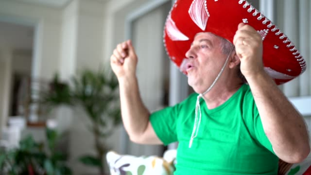 mexican fan celebrating at home - football strip stock videos & royalty-free footage