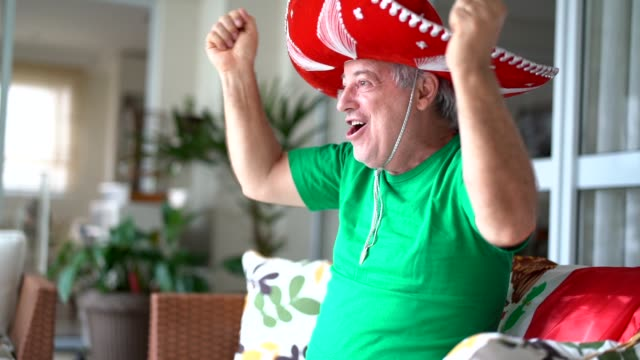 mexican fan celebrating at home - sombrero stock videos & royalty-free footage