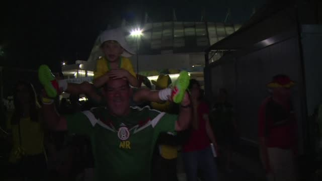 mexican fans celebrated their victory against croatia as they left the stadium in recife - sportweltmeisterschaft stock-videos und b-roll-filmmaterial
