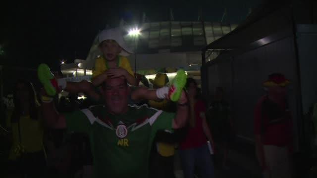 vídeos y material grabado en eventos de stock de mexican fans celebrated their victory against croatia as they left the stadium in recife - campeonato mundial deportivo