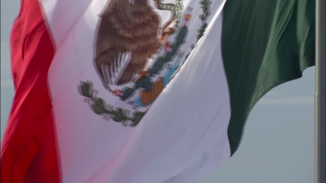SLO MO, CU, Mexican flag blowing in wind, Mexico