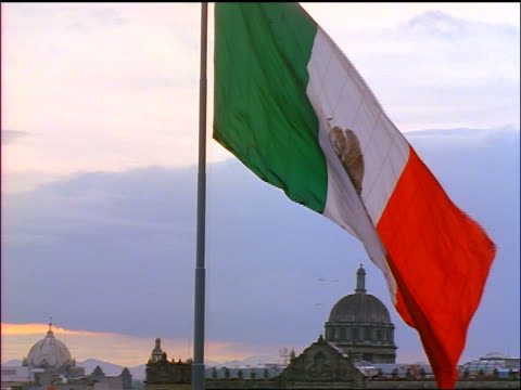mexican flag blowing in wind / national palace in background / mexico city, mexico - palace stock videos & royalty-free footage