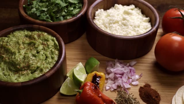 mexican food ingredients including guacomole, cilantro and cotija cheese - taco stock videos & royalty-free footage