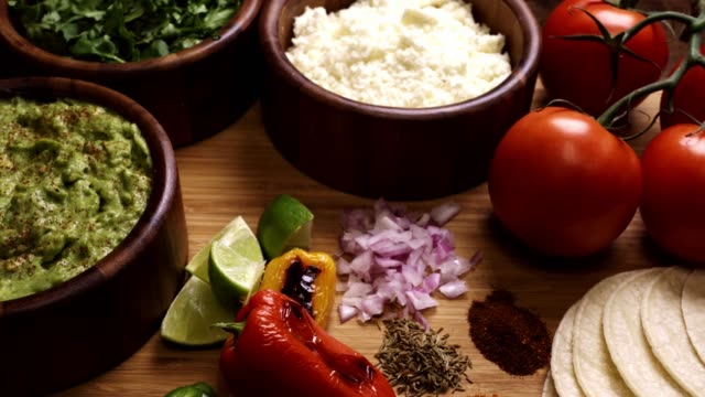 mexican food ingredients including guacomole, cilantro and cotija cheese - mexican food stock videos & royalty-free footage